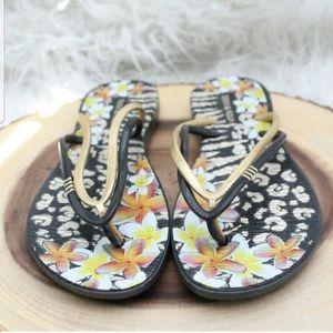 Shoes - Gold and black flip flops